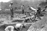 Laos, soldiers digging trenches for battle in Xiangkhoang