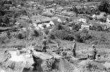 Laos, soldiers digging trenches on hill overlooking Xiangkhoang