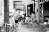 Vietnam, pedestrians outside tea shop in Ho Chi Minh City
