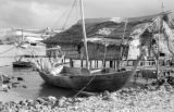 Indonesia, fishing boat and stilt home on waterfront