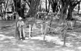 Laos, soldier standing at control point reinforced with barbed wire