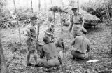 Malaysia, Gurkha soldiers discussing maneuvers on jungle patrol