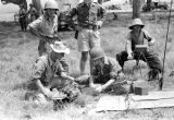 Laos, soldiers using communication equipment to contact headquarters from Xiangkhoang