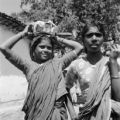 India, girls in saris standing near house in Hyderabad