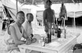 Vietnam, Senegalese troopers resting at table at Na Sản military camp