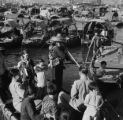 Hong Kong, people with children on sampan at port in Victoria