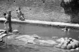 Nepal, children bathing at Budhanilkantha, statue of Lord Vishnu in Kathmandu