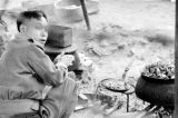 Vietnam, Vietnamese soldier cooking meal during First Indochina War