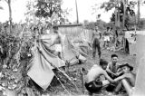 Laos, German and Vietnamese soldiers at camp in Pakxan