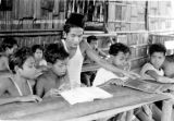 Malaysia, students reading from book in Pehang classroom