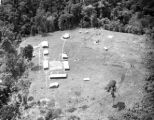 Malaysia, aerial view of jungle fort and helicopter pad