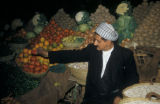 Baghdad (Iraq), man displaying vegetables at market