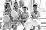 Malaysia, children holding balloons at celebration
