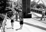 Singapore, children and men walking across bridge