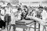 Singapore, man performing self flagellation in honor of God of Hell