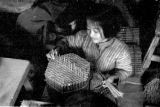 Macau, young girl making fireworks at Kwong Hing Tai Firecracker Company