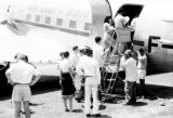 Laos, passengers boarding Air Laos airplane