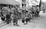 Laos, soldiers eating and resting during patrol of Xiangkhoang