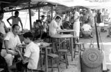 Singapore, people eating at outdoor café