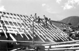 Malaysia, men constructing roof of building