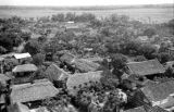 Vietnam, aerial view of town with thatched roof buildings