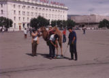 Ulaanbaatar (Mongolia), men with camel on the square