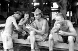 Laos, soldiers eating rations at military camp in Xiangkhoang