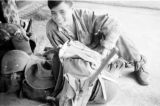 Laos, possibly Vietnamese soldier at military camp in Xiangkhoang