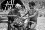 Malaysia, Semang men inspecting Pan American Airways bag