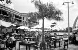 Singapore, patrons at hotel restaurant and swimming pool
