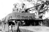 Laos, German soldiers riding in armed military vehicle