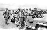 Laos, soldiers waiting in armed jeeps for convoy in Xiangkhoang