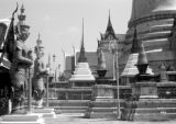 Thailand, pagoda and standing guard at Emerald Buddha temple (Wat Phra Kaew) in Bangkok