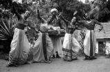Sri Lanka, portrait of four female dancers and male drummer in Kandy