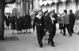 Russia, pedestrians on street along buildings in Moscow