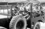 Malaysia, Gurkha soldiers riding in jeep in military camp