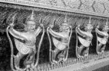 Thailand, golden statues on wall of Chapel Royal at Emerald Buddha temple (Wat Phra Kaew) in...