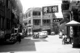 Macau, street with automobiles and pedestrians