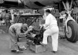 Taiwan, crew repairing aircraft parts at Tainan Airport