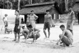Malaysia, Gurkha soldiers cutting wood at military camp