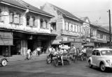 Thailand, buildings and motorcycle traffic on Pat Pong Road in Bangkok