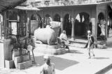 India, men near sacred cow statue at Durga Temple in Varanasi