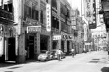 Macau, street scene with sign-covered shops
