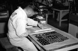 Taiwan, man working on labeling process at Civil Air Transport facility in Gaoxiong Gang