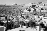 Jordan, buildings and tents along hillside in 'Ammān