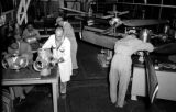 Taiwan, men working at Civil Air Transport propeller shop in Gaoxiong Gang