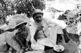 Israel, father and son resting at vineyard in Bethlehem