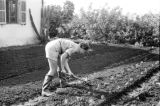 Israel, woman tending to garden at Nahalal girls' school