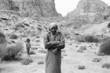 Jordan, portrait of man wearing headscarf in Petra