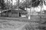 Philippines, structure near railroad track in Kolambugan